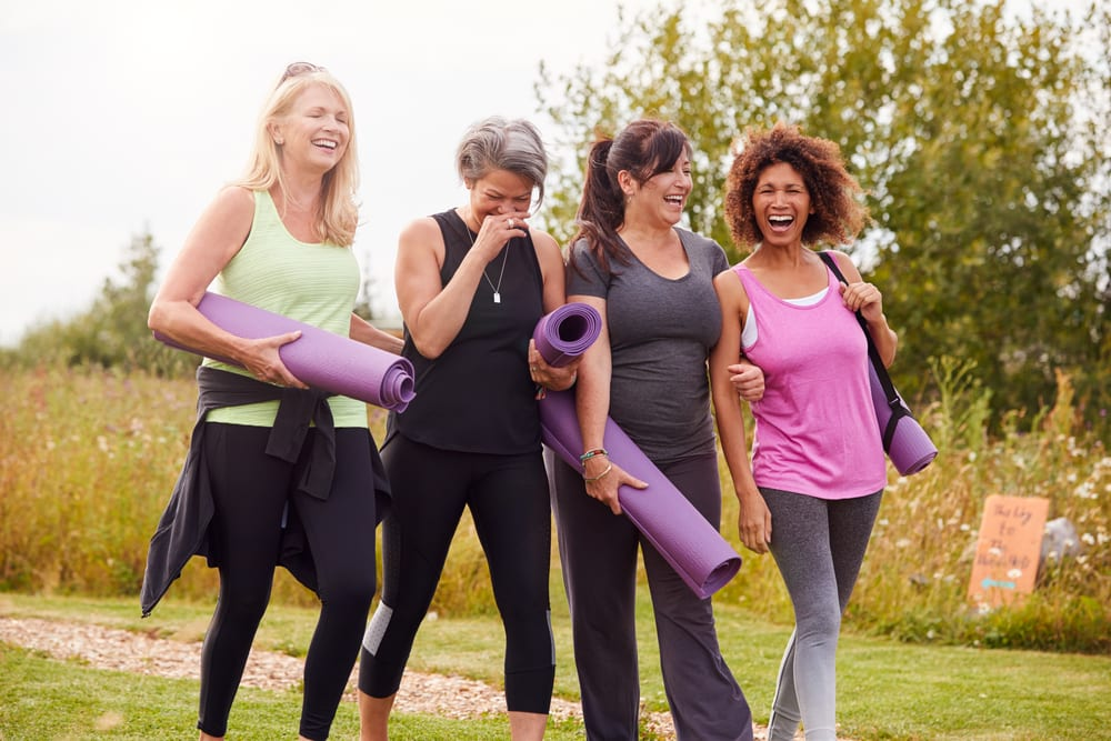 group of women laughing together after yoga class